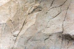 Kamienna ściana z szorstką teksturą Textured nawierzchniowy kamienny materia Obrazy Royalty Free