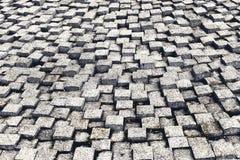 Kamienna bruk tekstura Granit brukuje dryluj?cego bruku t?o Abstrakcjonistyczny tło stary brukowa bruk w górę 2 fotografia royalty free