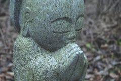 Kamienna Buddha statua w drewnach Obraz Royalty Free