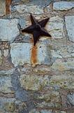 Kamienna cegiełki ściana z gwiazdą Obraz Stock
