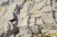 Kamienna tekstura, zakończenie żółta kamienna ściana Obrazy Stock