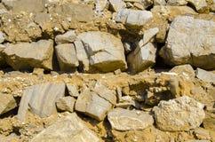 Kamienna tekstura, zakończenie żółta kamienna ściana Obraz Royalty Free