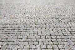 Kamienna uliczna drogowego bruku tekstura fotografia royalty free