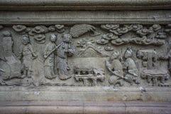 Kamiennego cyzelowania Chińska sztuka wokoło Tajlandzkiej świątyni w Wacie Pichaya-yatogaram fotografia stock