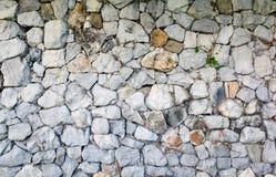 Kamiennej ściany wzoru szarość barwią powierzchnię, tło zdjęcia royalty free