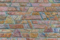 Kamiennej ściany tło; brown czerwień wzór blokuje tapetę Fotografia Royalty Free