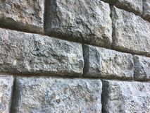Kamiennej ściany tekstura z dużymi cegłami na antycznym historycznym budynku fotografia stock