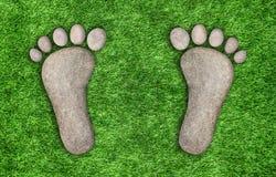 Kamienni odciski stopy w trawie royalty ilustracja