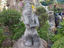 Kamienny świątynny bóg z powodów Wata Pho w Bangkok, Tajlandia Obraz Royalty Free