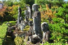 Kamienny Buddhas przy Japońską świątynią, Kyoto Japonia Fotografia Royalty Free