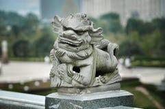 Kamienny cyzelowanie lew w Chiny zdjęcia royalty free