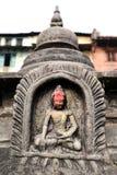Kamienny posążek siedzieć Buddha w Swayambhunath Nepal Fotografia Stock