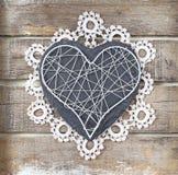 Kamienny serce na drewnianym tle fotografia stock