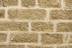 Kamienny stary ścienny tło z sklejonymi kamieniami obrazy stock