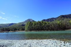 Kamikochi. Is the crown jewel of the Japanese Alps. The scenic area is a basin at 1500 meters elevation. One of the most beautiful tensions hangs between the Royalty Free Stock Photography