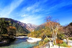 Kamikochi. Is the crown jewel of the Japanese Alps. The scenic area is a basin at 1500 meters elevation. One of the most beautiful tensions hangs between the Royalty Free Stock Image