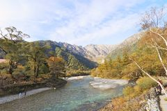 Kamikochi. Is the crown jewel of the Japanese Alps. The scenic area is a basin at 1500 meters elevation. One of the most beautiful tensions hangs between the Royalty Free Stock Photos
