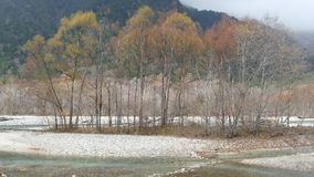 Kamikochi National Park in the Northern Japan Alps of Nagano Prefecture, Japan. Beautiful mountain in autumn leaf with river. Kamikochi , Japan - Nov 3, 2014 stock video