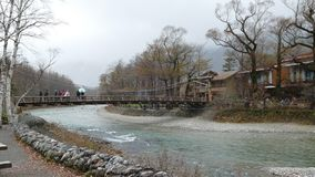 Kamikochi National Park in the Northern Japan Alps of Nagano Prefecture, Japan. Beautiful mountain in autumn leaf with river. Kamikochi , Japan - Nov 3, 2014 stock video footage