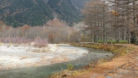 Kamikochi National Park in the Northern Japan Alps of Nagano Prefecture, Japan. Beautiful mountain in autumn leaf with river. Kamikochi , Japan - Nov 3, 2014 stock footage