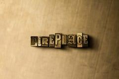 KAMIN - Nahaufnahme des grungy Weinlese gesetzten Wortes auf Metallhintergrund Lizenzfreie Stockbilder