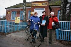 Postwoman with bike Stock Photography