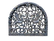 Kamintür mit metallischem Drachen Stockfoto