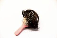 kammar hår Arkivfoton