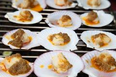 Kammossel die met botersaus wordt geroosterd Royalty-vrije Stock Fotografie