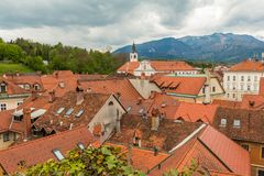 Kamnik city scape and alps at background. Royalty Free Stock Photos