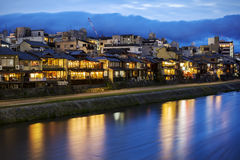 Kamogawa river embankment in Kyoto. Night view on the Kamogawa river embankment in Kyoto. Restaurant lights reflected in the river Royalty Free Stock Photo
