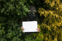 Kamouflage med tecknet Arkivfoto