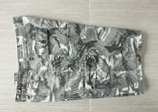 Kamouflageflåsande fotografering för bildbyråer