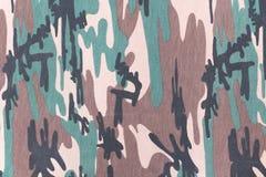 Kamouflagemodell och bakgrund Arkivbild
