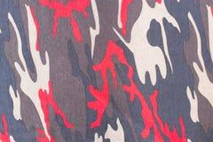 Kamouflagemodell och bakgrund Fotografering för Bildbyråer