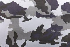 Kamouflagemodell och bakgrund Royaltyfri Bild