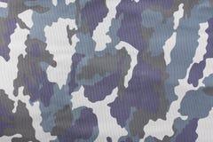 Kamouflagemodell och bakgrund Royaltyfri Fotografi