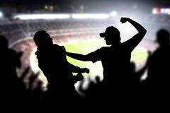 Kamp i en folkmassa för fotbolllek royaltyfria foton