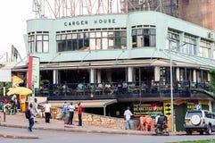 Kampala Road with cafe, Kampala, Uganda. Pedestrians on Kampala Road, and diners in coffee shop, Kampala, Uganda Royalty Free Stock Photography
