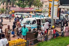 Taxi on Kampala Road, Kampala, Uganda. Kampala Road scene near Constitution Square with with pedestrians and taxi mini-bus, Kampala, Uganda Stock Photos