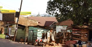 Kampala Roadside View. A view along a roadside in Kampala showing local residences and road side businesses royalty free stock image