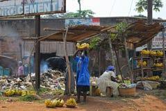 Kampala slum, Uganda. KAMPALA, UGANDA - AUG 26: Native people sell banana at local market on Aug 26, 2010 in slum of Kampala, Uganda. Nearly 40% of slum dwellers Royalty Free Stock Photo