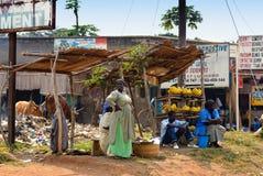 Kampala slum, Uganda. KAMPALA, UGANDA - AUG 26: Native people sell banana at local market on Aug 26, 2010 in slum of Kampala, Uganda. Nearly 40% of slum dwellers Royalty Free Stock Photos