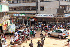 Kampala Street Corner. KAMPALA, UGANDA - SEPTEMBER 29 2012.  Many locals go about their business on a street corner in downtown Kampala, Uganda on September 29 Stock Photography