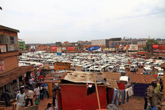 Kampala Taxi Centre and Vendors. KAMPALA, UGANDA - SEPTEMBER 28, 2012.  People shop among the vendors surrounding the busy and crowded central taxi park in Stock Photography