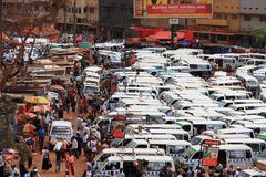 Kampala Taxi Park Business. KAMPALA, UGANDA - SEPTEMBER 28, 2012.  Daily life and business moves along in the busy and bustling taxi park of  Kampala, Uganda on Stock Image