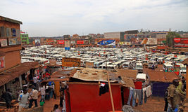 Kampala Taxi Park. KAMPALA, UGANDA - SEPTEMBER 28, 2012 - Hundreds of public transport taxis, wait for passengers in the extremely large and crowded taxi park in Royalty Free Stock Images