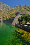 Kampana Tower outside of Kotor Old Town with Green River Stock Image