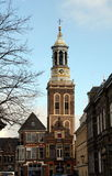 Kampen. February-19-2014.The New Tower from 1465 and historic houses in Stock Image