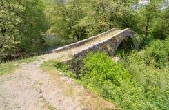 Kamper Aga stone bridge, Epirus, Greece. Old one-arch stone bridge, on the contribution of the rivers Vardas and Zagoritikos near the village of Miliotades, in Royalty Free Stock Photo
